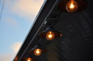 photo of lightbulbs along a roof