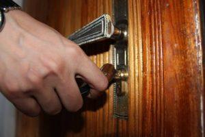 image of person opening door