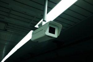a security camera in a dark industrial building